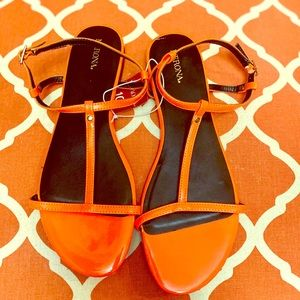 Bright orange sandals. NWT size 10
